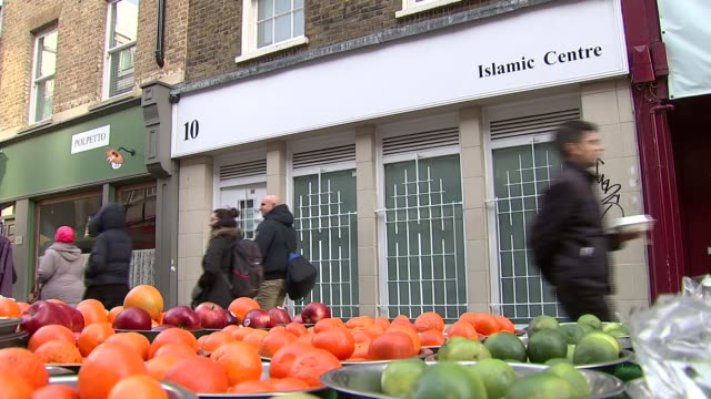 Soho Islamic Centre bans women worshipers due to lack of space ENGLAND London EXT Various shot muslim men entering Soho Islamic Centre Sign in window...