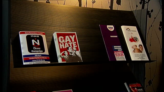 lesbian gay and bisexual tourist office gary henshaw putting out pamphlets gary henshaw interview sot westminster police poster on wall - bisexuality stock videos and b-roll footage