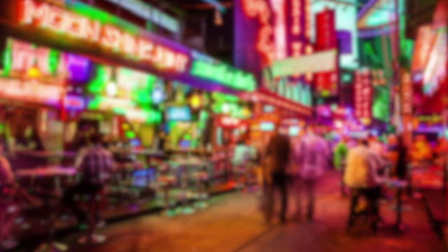 Soi Cowboy red light district in Bangkok, Thailand at night, timelapse (blurred for commercial use)