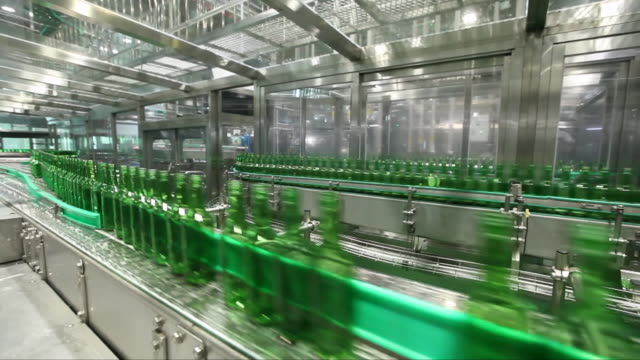 soju (korean alcohol) bottles on conveyor belt at a manufacturing factory - conveyor belt stock videos & royalty-free footage