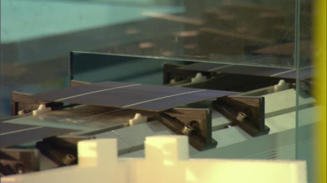 vídeos de stock, filmes e b-roll de cu solar cells on conveyor at manufacturing facility, thalheim, bitterfeld-wolfen, germany - movimento perpétuo