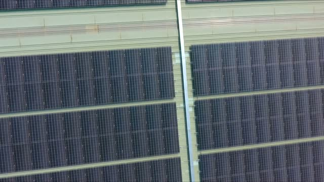 solar cells on the roof of large buildings. - air to air shot stock videos & royalty-free footage