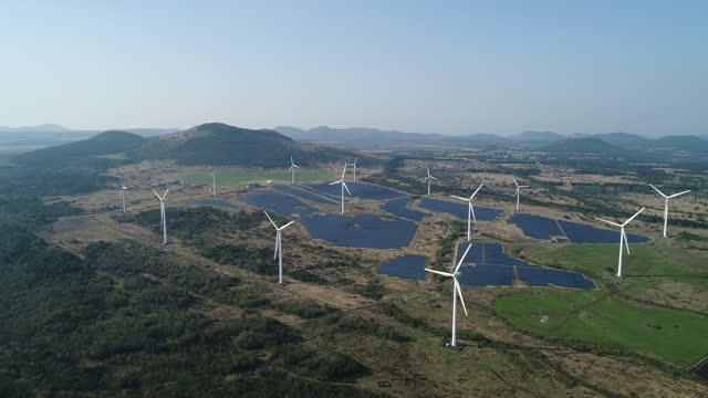 solar collector and wind turbine / jeju-do, south korea - horizon over land stock videos & royalty-free footage