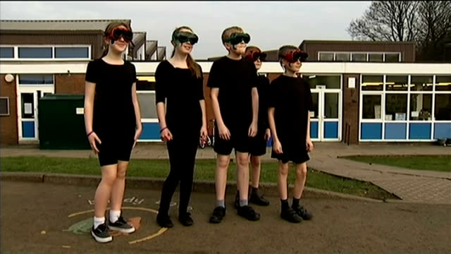 solar eclipse across the uk and europe england greater manchester bury ext various shots of school children wearing protective glasses watching the... - solar eclipse glasses stock videos and b-roll footage