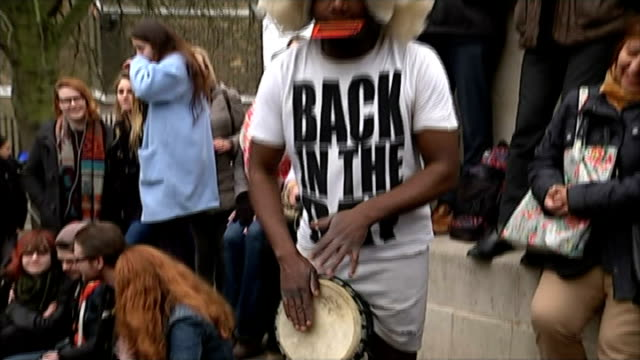 solar eclipse across the uk and europe england london greenwich ext man in fancy dress playing drums people dancing in street to drum playing - eclipsed 2015 play stock videos and b-roll footage
