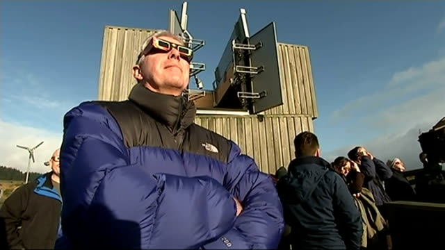 solar eclipse across the uk and europe england northumberland kielder int man looking through telescope in observatory partial eclipse in cloudy sky... - solar eclipse glasses stock videos and b-roll footage