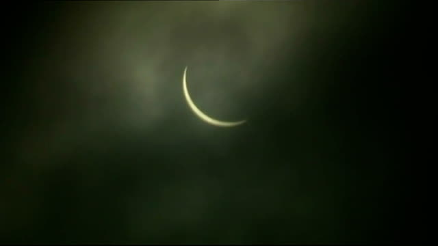solar eclipse across the uk and europe scotland aberdeen gv 95% solar eclipse bvs people in silhouette watching eclipse ground to air gv 95% solar... - solar eclipse glasses stock videos and b-roll footage