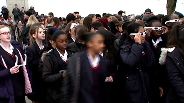 solar eclipse across the uk and europe various shots schoolchildren with eclipse glasses - solar eclipse glasses stock videos and b-roll footage
