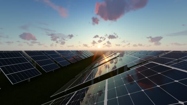 solar energy panels at sunrise background - pannello di controllo video stock e b–roll