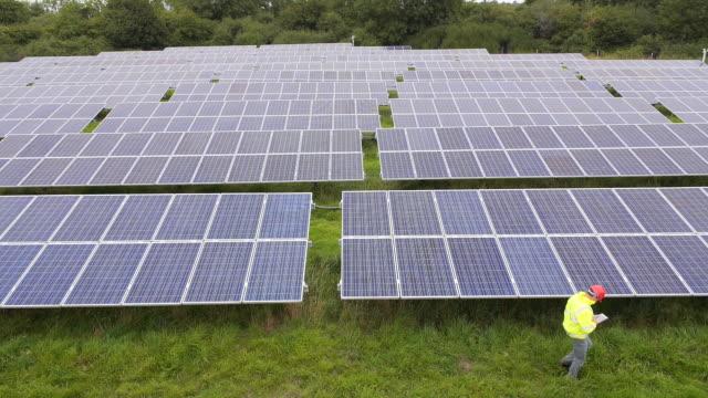 solar farm, aerial view - solar energy stock videos & royalty-free footage