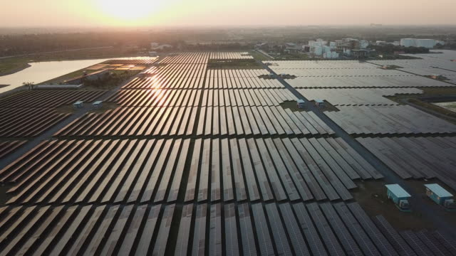 solar farm in aerial view - sustainable energy stock videos & royalty-free footage