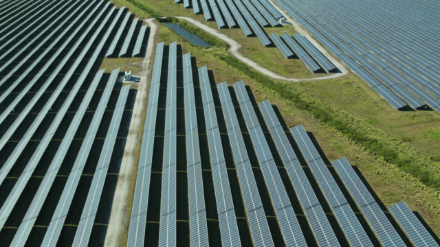 solar farm in florida - aerial view - power supply stock videos & royalty-free footage
