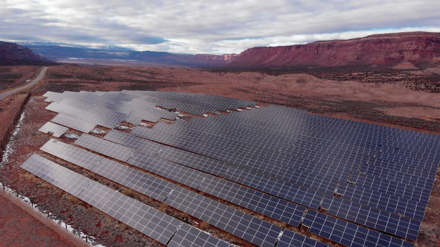 a solar farm just off the highway in the high desert of western colorado and the eastern utah border, the la sal mountains in the background - control panel stock videos & royalty-free footage