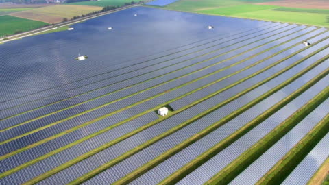 solar field aerial video - air to air shot stock videos & royalty-free footage