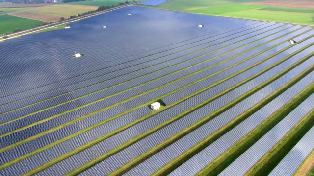 solar field aerial video - air to air shot stock videos and b-roll footage