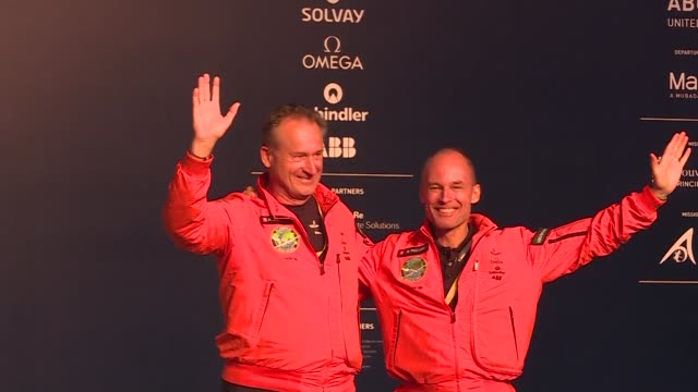 vídeos de stock, filmes e b-roll de solar impulse 2 pilots speak to the press after landing in the uae completing the aircraft's epic journey to become the first sun powered airplane to... - veículo com combustível alternativo