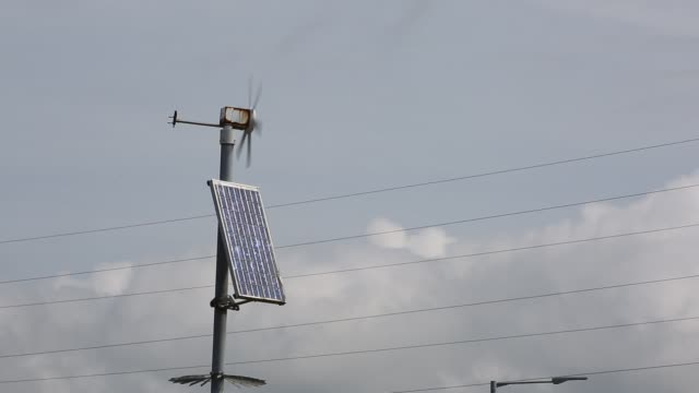 a solar panel and wind turbine on a post in barrow in furness cumbria uk - sustainable energy stock videos & royalty-free footage