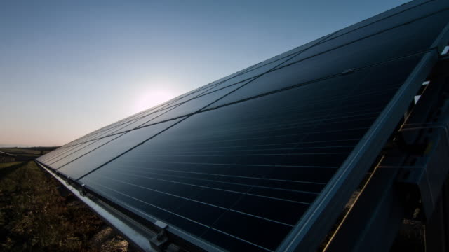 solar panel at sunset - power supply stock videos & royalty-free footage