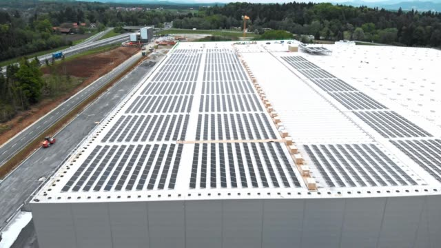 solar panel construction on the roof of a massive hangar - self storage stock videos and b-roll footage