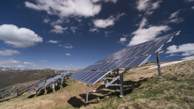 solar panel european alps time lapse - österreich stock-videos und b-roll-filmmaterial