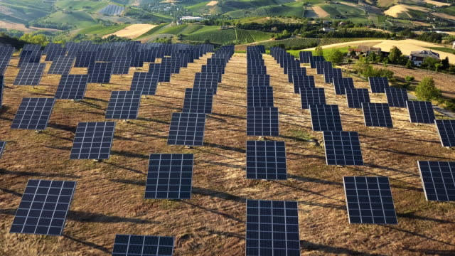 solar panel green energy field on hills - industry stock videos & royalty-free footage