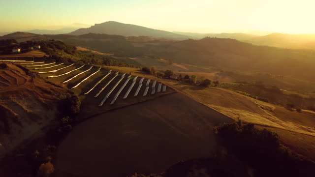 solar panel green energy field on hills - generator stock videos and b-roll footage