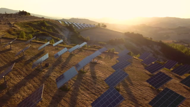 solar panel green energy field on hills - energia solare video stock e b–roll