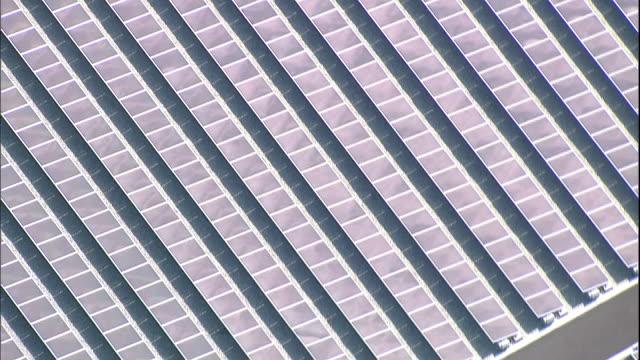 Solar panel grids line the Sakai Solar Power Plant