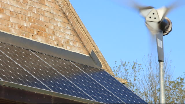 vidéos et rushes de solar panels and a small wind turbine on a building near billingham in the north east, uk. - de petite taille
