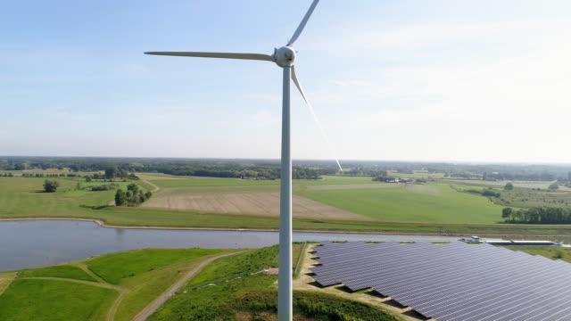 solar panels and wind turbine - slätt bildbanksvideor och videomaterial från bakom kulisserna