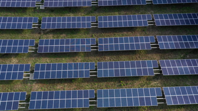 solar panels fields on the green hills - wafer stock videos and b-roll footage