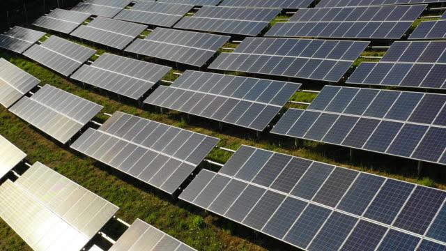 Solar panels fields on the green hills