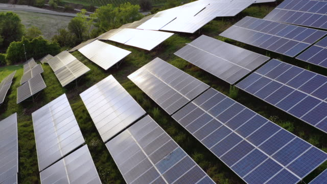 solar panels fields on the green hills - power supply stock videos & royalty-free footage