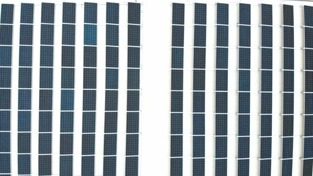solar panels in line on a white roof - self storage video stock e b–roll