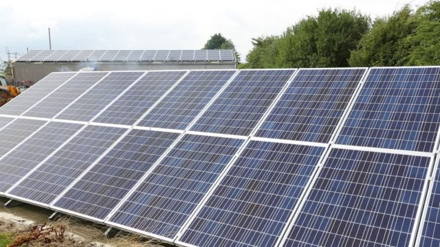 solar panels in the garden of a house near aldbrough, yorkshire, uk. - power supply stock videos & royalty-free footage