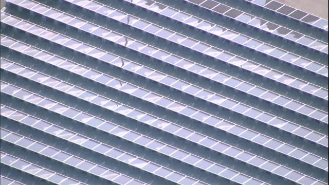 Solar panels line a grid at the Sakai Solar Power Plant