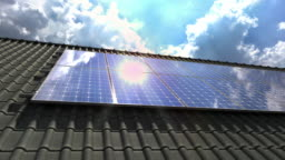 Solar panels modules on roof with sun and clouds reflecting