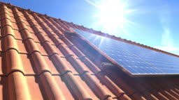 Solar panels modules on roof with sun reflecting