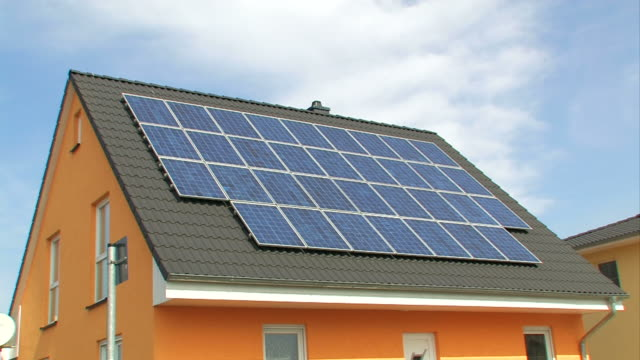solar panels on a roof - photovoltaic cells - solar power station stock videos and b-roll footage