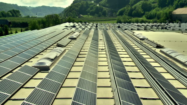 aerial solar panels on an industrial building - solar power station stock videos and b-roll footage