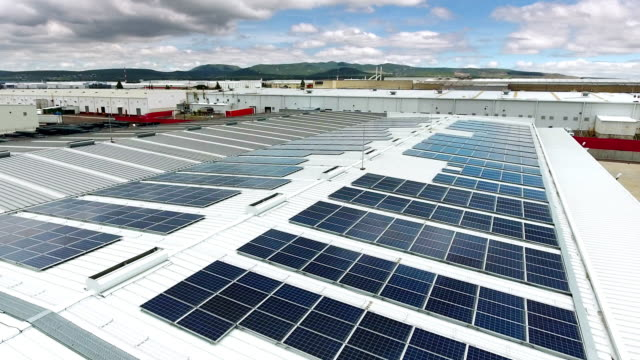 solar panels on factory roof - rooftop stock videos & royalty-free footage