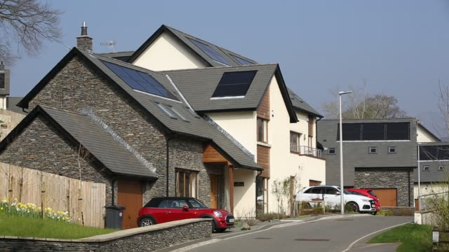 solar panels on new build houses in ambleside, lake district, uk. - building activity stock videos & royalty-free footage