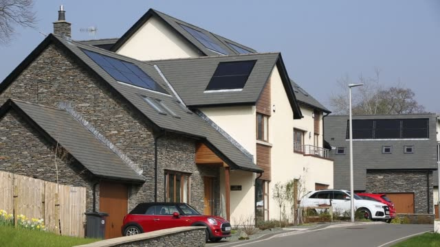 solar panels on new build houses in ambleside, lake district, uk. - solar panels stock videos & royalty-free footage