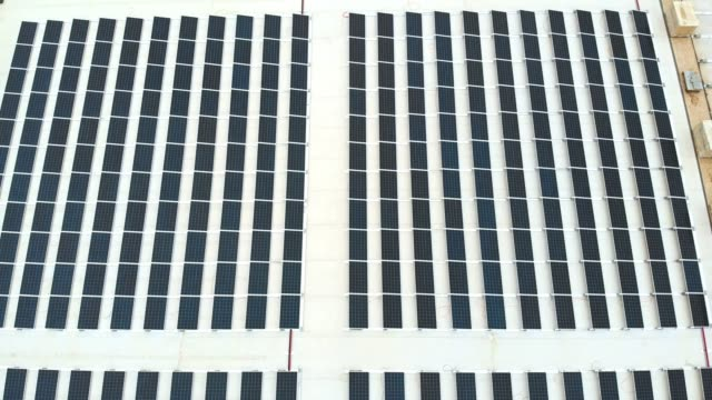 solar panels on the roof of a storage facility - self storage stock videos and b-roll footage