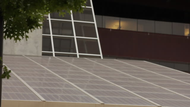 solar panels on the roof of austin city hall close - town hall stock videos & royalty-free footage