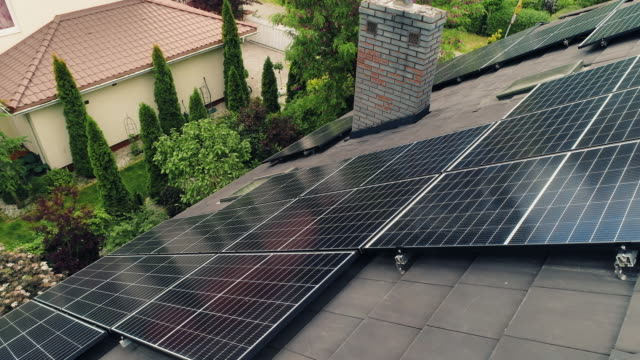 solar panels on the rooftops. aerial view. - power in nature stock videos & royalty-free footage