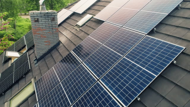 solar panels on the rooftops. aerial view. - industrial equipment stock videos & royalty-free footage
