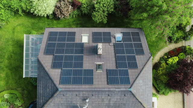 solar panels on the rooftops. aerial view. - zoom in stock videos & royalty-free footage