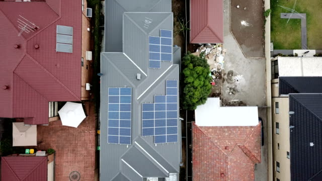 solar panels on the rooftops. aerial view - rooftop stock videos & royalty-free footage