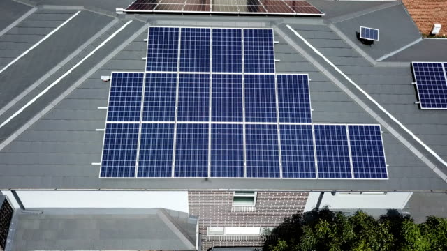 solar panels on the rooftops. aerial view - roof stock videos & royalty-free footage